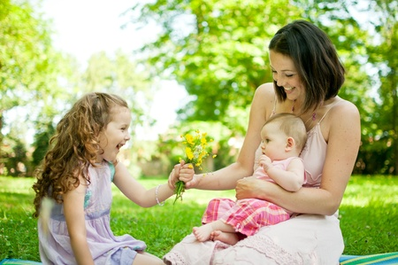 candid: Happy life - mother with children Stock Photo