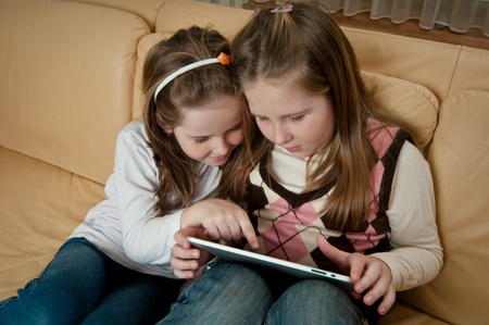 Children playing with tablet photo