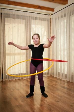 Young girl dancing with hoop photo