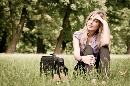 sad lonely: Frustration - young woman outdoors Stock Photo