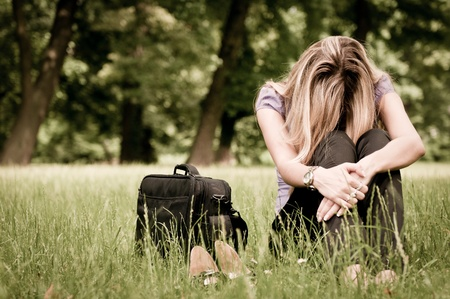 feeling sad: Frustration - young woman outdoors Stock Photo