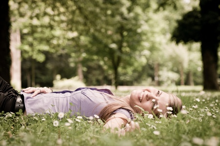 Happy life - lying in grass with flowers photo