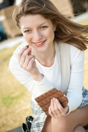 hapiness: Young woman eating chocolate