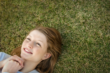Young happy woman in grass Stock Photo - 12915819