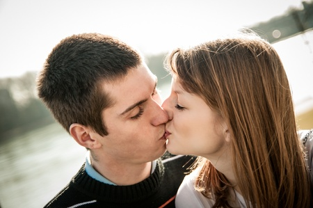 Young kissing couple in love Stock Photo - 12915815