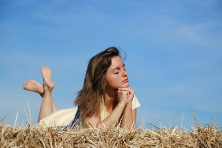 Young woman lying in hay Stock Photo - 12915400