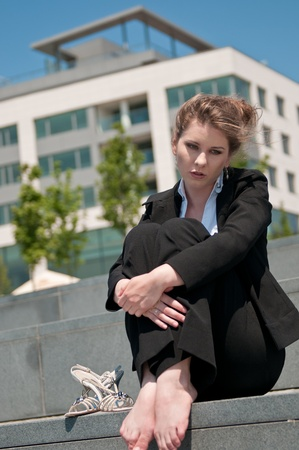 Troubled young business woman photo