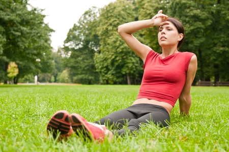 Relax in grass - tired woman after sport Stock Photo - 13081521