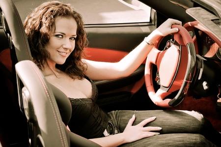sexy woman car: Young beautiful woman in sport car