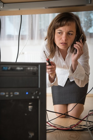 computer support: Computer problem - business woman need help Stock Photo