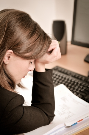 Depressed business person with headache in work Stock Photo - 13649507