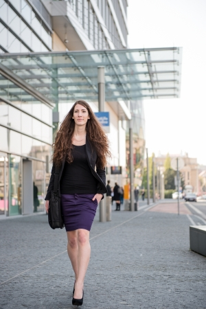Business woman walking in hurry Stock Photo - 13649560