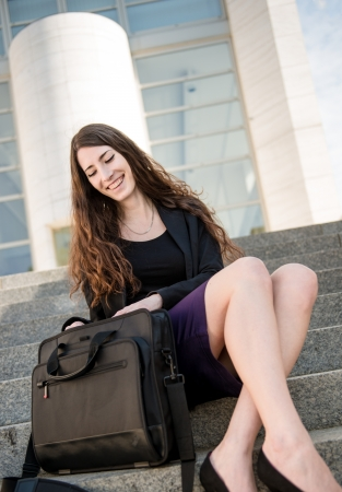 Business woman looking in laptop bag Stock Photo - 13649551