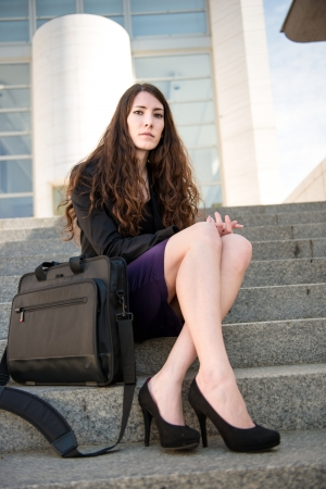 skirt suit: Business woman portrait on stairs Stock Photo