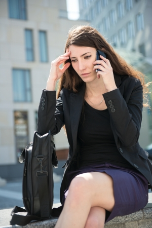 Business woman calling phone - problems Stock Photo - 13649545