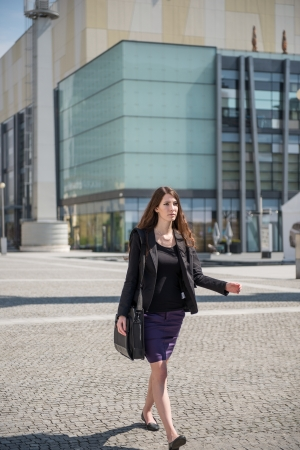 Business woman walking in hurry Stock Photo - 13649566
