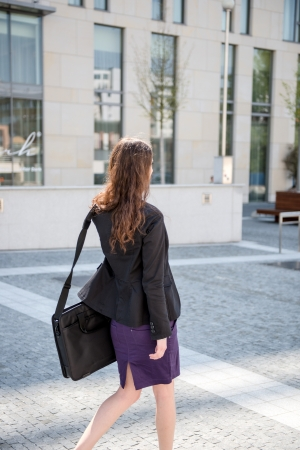 suit skirt: Business woman walking in hurry