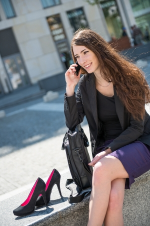 skirt suit: Business woman walking on stairs calling phone