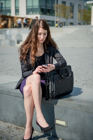 Problems - business woman reading message on phone Stock Photo - 13649580
