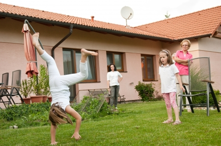 backyard woman: Children doing cartwheels in backyard