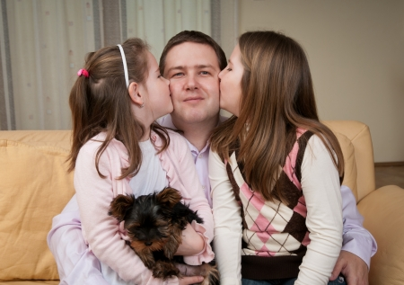 Love - children kissing father photo