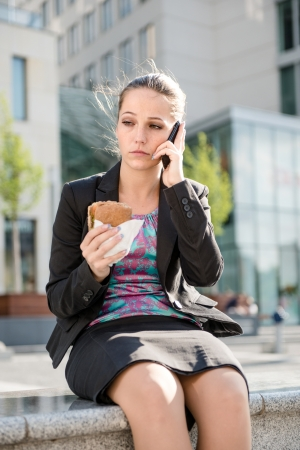 Business woman calling phone - problems Stock Photo - 13961263