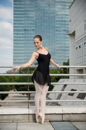Ballet dancer dancing on street photo