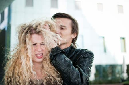 annoying: Ruffle hair - couple outdoors Stock Photo