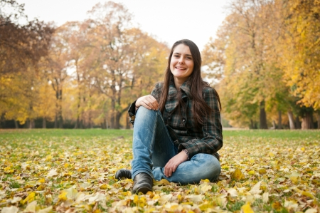 sitting on the ground: Happy fall lifestyle portrait