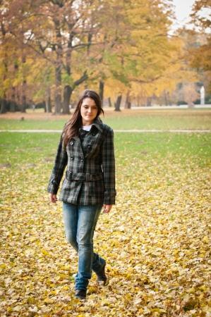 Autumn joy - young woman outdoor photo