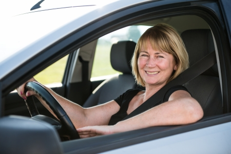 Portrait of senior woman in car photo