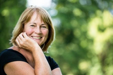 happy retirement: Smiling mature woman outdoor portrait Stock Photo
