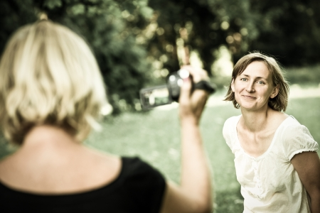 taking video: Senior mother is taking video of her child Stock Photo