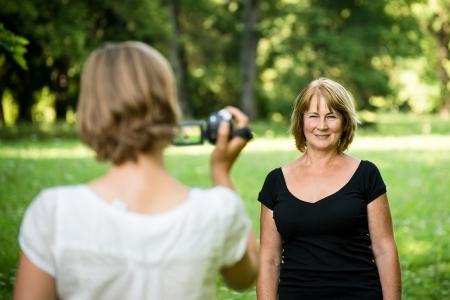taking video: Woman is taking video of her mother Stock Photo