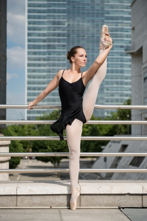 classic contrast: Ballet dancer dancing on street Stock Photo