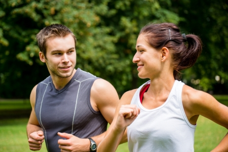 woman jogging: Training together - young couple jogging