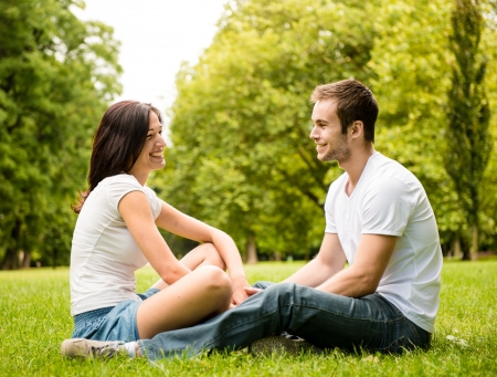 tenager: Young couple talking outdoor