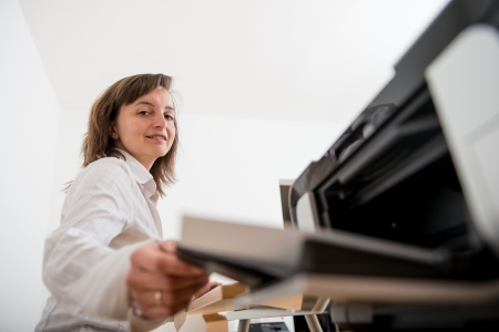 printer: Business person working woth printer