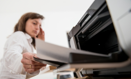 Depressed business person working with printer photo