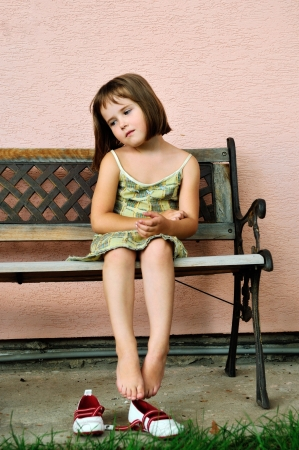 little girl barefoot: Vintage mood - sad child portrait Stock Photo