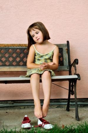 young feet: Vintage mood - sad child portrait Stock Photo