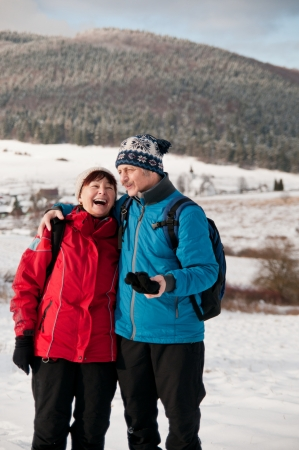embracement: Senior retired couple in winter together Stock Photo