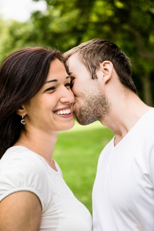Young kissing couple in love photo