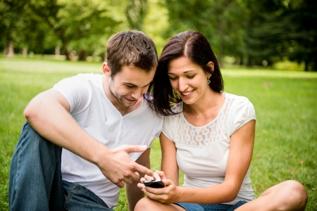 Young couple with smartphone photo