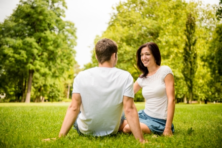 two people talking: Young couple talking outdoor