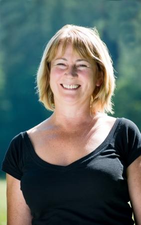 Smiling mature woman outdoor portrait Stock Photo
