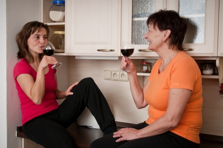 Happy life - mother and daughter drinking wine photo