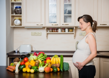 human pregnancy: Pregnant woman - healthy food Stock Photo