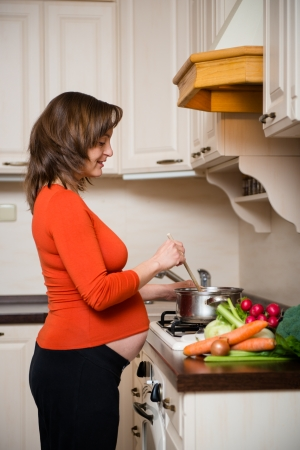 Pregnant woman cooking Stock Photo - 17080163
