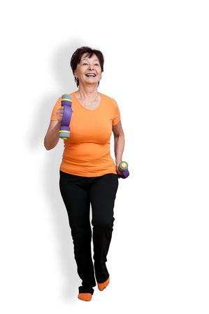 senior fitness: Senior woman exercising - on white Stock Photo